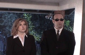 Jean Black and Jim Rainey as FBI